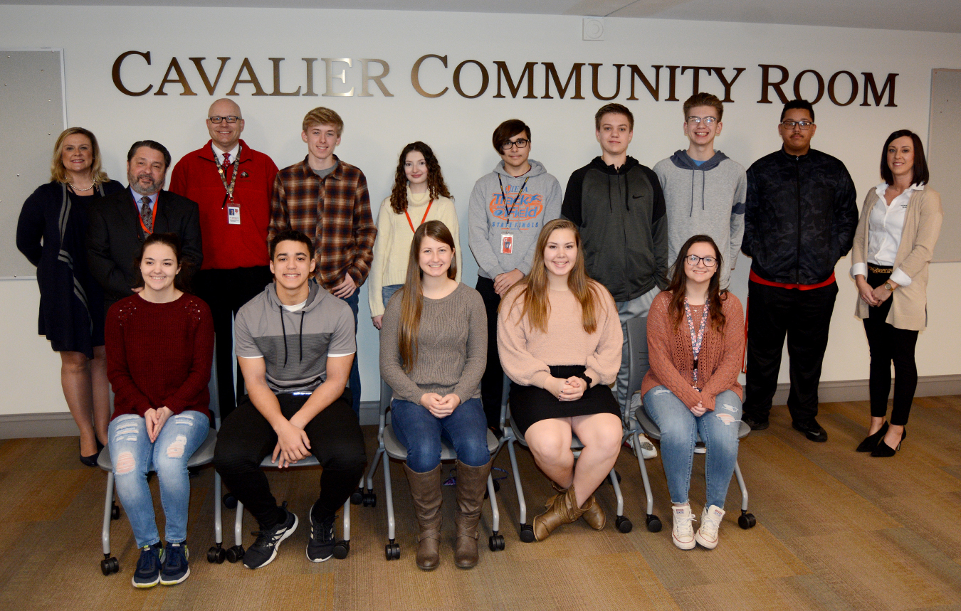 Students selected for Renaissance Students of the Month posing with school administrators.
