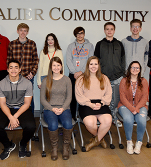 Students who were selected for Students of the Month sitting in the Cavalier Community Room.