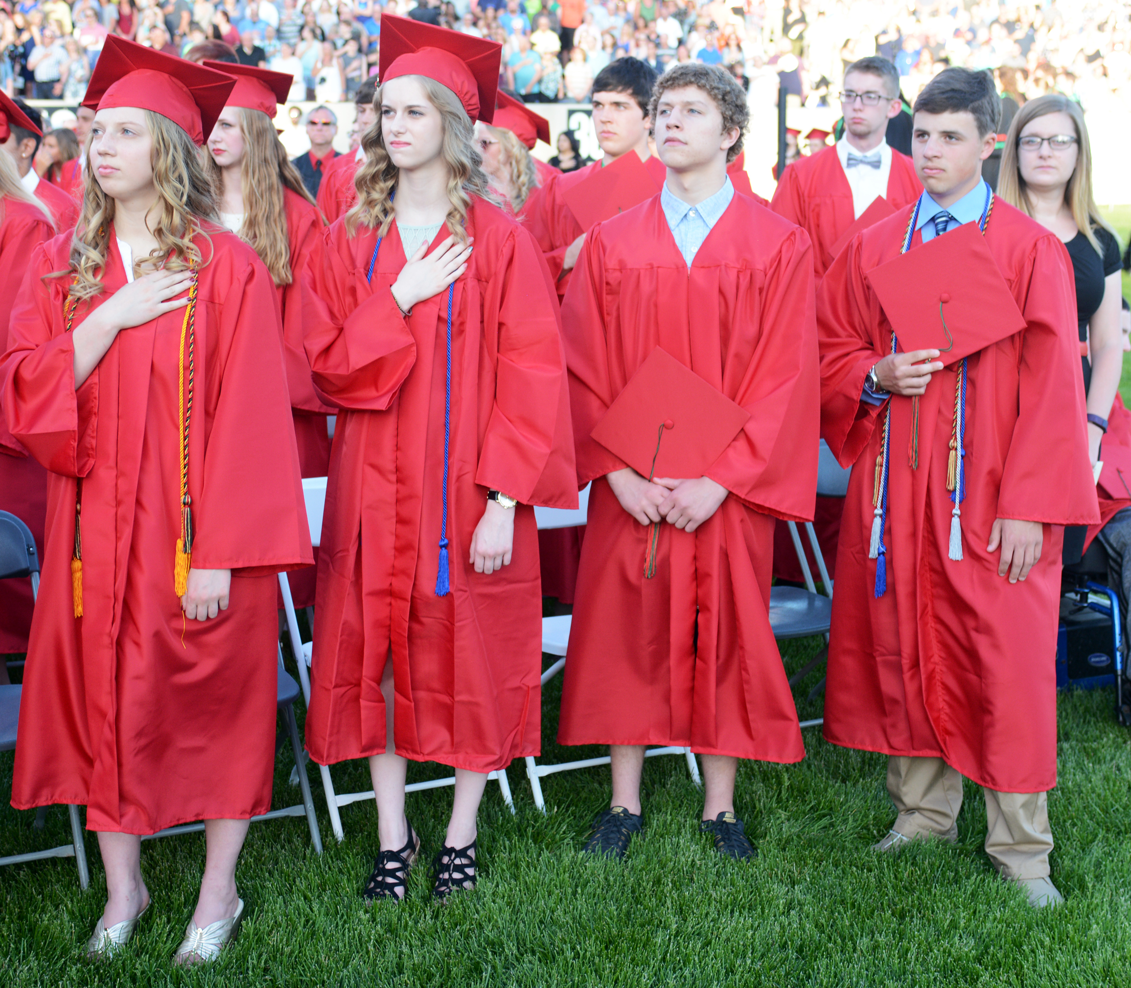 Students stand during an LPHS graduation ceremony.